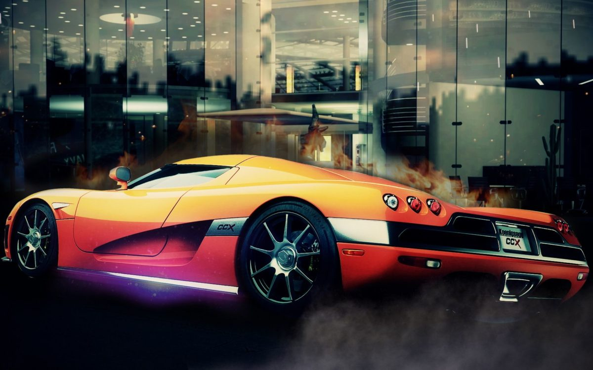 Orange Koenigsegg CCX in Front of Building   CARS